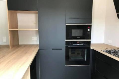 Cuisine noire et bois, une cuisine réalisée par SoCoo'c Rodez