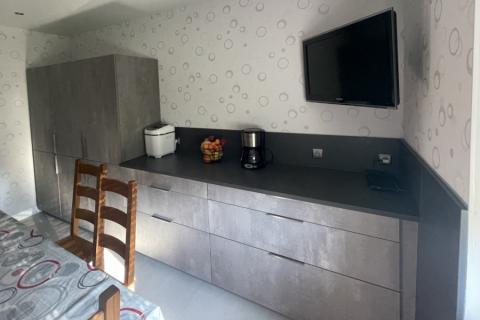 Une cuisine grise, type cimento, une cuisine réalisée par SoCoo'c Phalsbourg