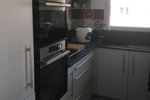 Cuisine en u avec intégration d'une cave à vin, une cuisine réalisée par SoCoo'c Chalon sur Saône